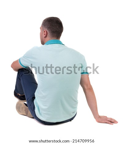 Back view of seated handsome man in polo looking up.   Standing young guy in jeans. Rear view people collection.  backside view of person.  Isolated over white background. - stock photo