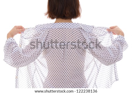 Back view of sexy woman taking off her clothes