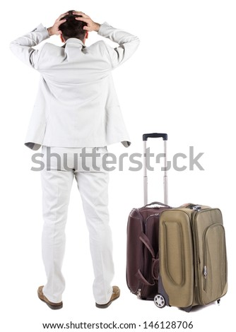 Back view of shocked business man with suitcase looking up. Rear view people collection.  backside view of person.  Isolated over white background. upset businessman - stock photo