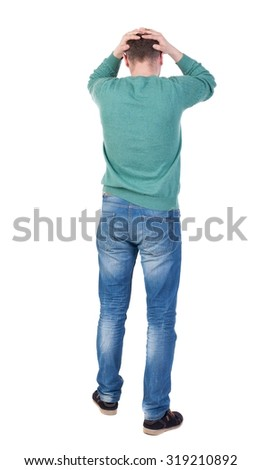 Back view of shocked  man .   upset young guy in jeans and shirt. Rear view people collection.  backside view of person.  Isolated over white background.