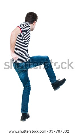 back view of skinny guy funny fights waving his arms and legs. Isolated over white background. Rear view people collection.  backside view of person.  - stock photo