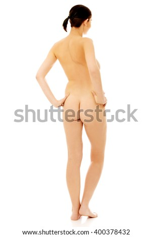 Back view of slim nude woman standing - stock photo