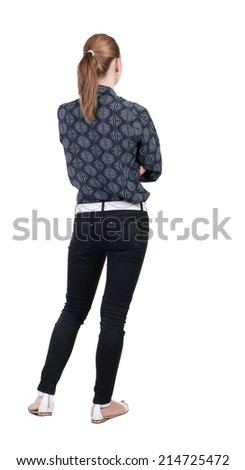 back view of standing young beautiful  blonde woman in jeans. girl  watching. Rear view people collection.  backside view of person.  Isolated over white background. - stock photo
