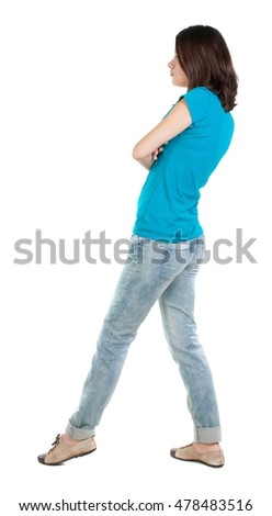 back view of standing young beautiful  brunette woman in jeans. girl  watching. Rear view people collection.  backside view of person.  Isolated over white background.