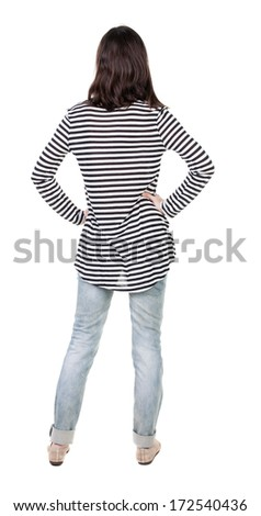 back view of standing young beautiful  brunette woman in striped frock. girl  watching. Rear view people collection.  backside view of person.  Isolated over white background. - stock photo