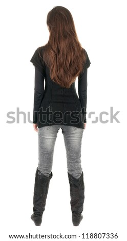 back view of standing young beautiful  woman.  brunette girl in jeans and sweater watching. Rear view people collection.  backside view of person.  Isolated over white background. - stock photo