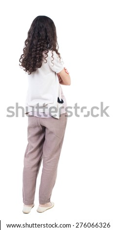 back view of standing young beautiful  woman.  girl  watching. Rear view people collection.  backside view of person. Isolated over white background. curly girl standing sideways with his arms crossed - stock photo