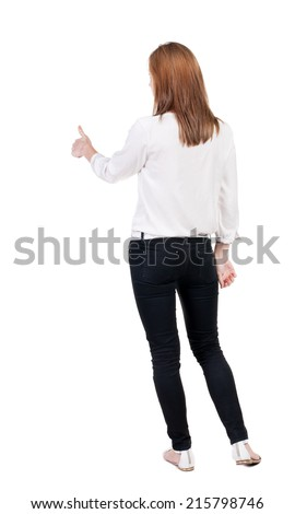back view of standing young blonde business woman showing thumb up. businesswoman in black suit gesturing ok sign. Rear view people collection. backside view person. Isolated over white background - stock photo