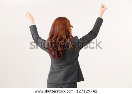 back view of the woman arm raising - stock photo