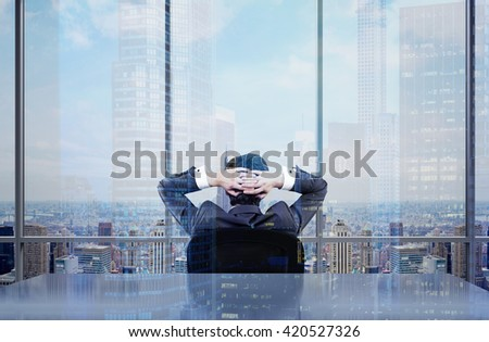 Back view of thoughtful  businessman sitting on chair in office admiring New York city view. Double exposure - stock photo