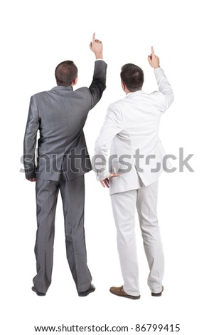 Back view of two businessman pointing at wall. rear view. Isolated over white . - stock photo