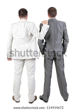 Back view of Two businessmen discuss. Rear view people collection.  backside view of person.  Isolated over white background. - stock photo