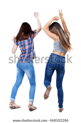 Back view of two dancing young women. Dance party. girls teens dance, enjoy and express positive emotions and having fun. backside view of person.  Rear view people collection. Isolated over white