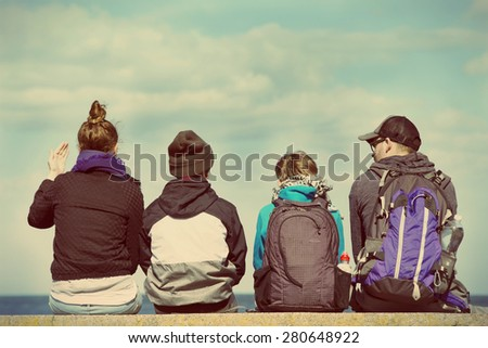 Back view of two generation family sitting. Instagram effect - stock photo