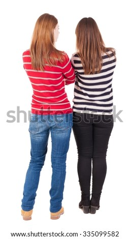 Back view of two young girl (brunette and blonde)  . Rear view people collection.  backside view of person. beautiful woman friends  showing gesture. Rear view. Isolated over white background. - stock photo