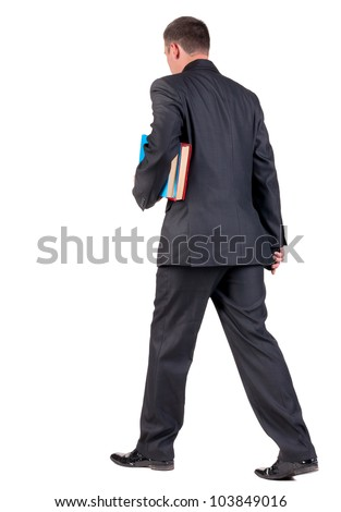 back view of walking  business man with books. going young guy in black suit. Isolated over white background. Rear view people collection. backside view of person - stock photo