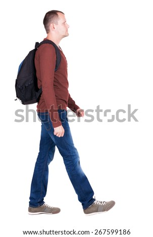 back view of walking  man  with backpack.backside view of person.  Rear view people collection. Isolated over white background. young man goes to side of a rolling travel bag on wheels - stock photo