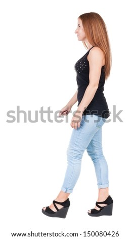 back view of walking  woman. beautiful redhead girl in motion.  backside view of person.  Rear view people collection. Isolated over white background.