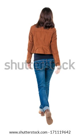 back view of walking  woman in brown jacket. beautiful brunette girl in motion.  backside view of person.  Rear view people collection. Isolated over white background. - stock photo