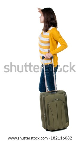 back view of walking  woman  in cardigan with suitcase pointing. beautiful  girl in motion.  backside view of person.  Rear view people collection. Isolated over white background.