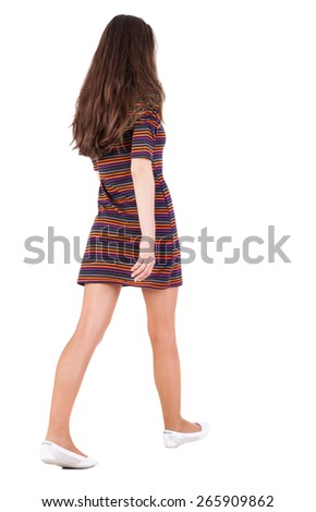 back view of walking  woman in dress . beautiful brunette girl in motion.  backside view of person.  Rear view people collection. Isolated over white background.  - stock photo