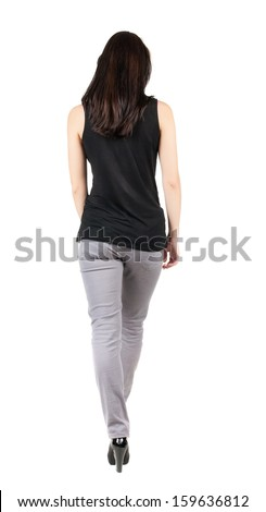 back view of walking  woman in gray trousers. beautiful brunette girl in motion.  backside view of person.  Rear view people collection. Isolated over white background.  - stock photo
