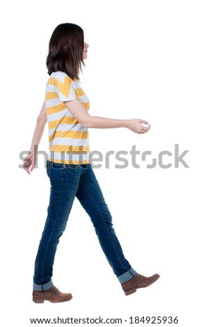 back view of walking  woman in jeans . beautiful brunette girl in motion.  backside view of person.  Rear view people collection. Isolated over white background. - stock photo
