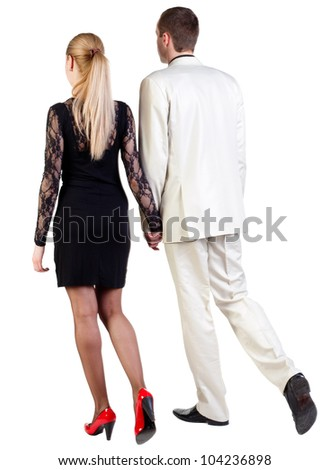 Back view of walking  young business team  (man and woman). going beautiful friendly girl in dress and guy in suit. Rear view people collection. backside view of person. Isolated over white background
