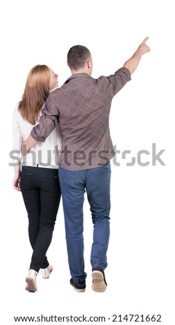 Back view of walking young couple (man and woman) pointing. Rear view people collection. backside view of person. Isolated over white background - stock photo