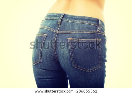 Back view of woman buttocks in jeans.