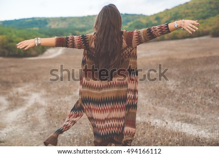 Back view of woman in boho style