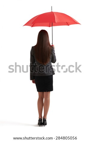 back view of woman in formal wear under red umbrella. isolated on white background - stock photo