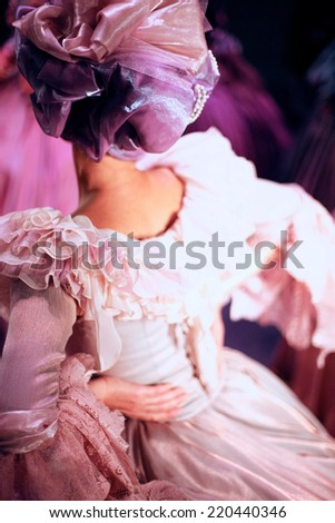 Back view of woman in luxurious vintage dress - stock photo