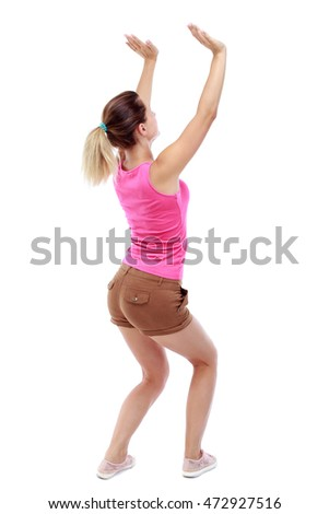 back view of woman  protects hands from what is falling from above. woMan holding a heavy load Rear view people collection.  backside view of person.  Isolated over white background. Sport blond in