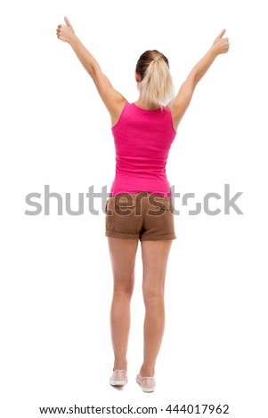 Back view of  woman thumbs up. Rear view people collection. backside view of person. Isolated over white background. Blonde in brown shorts showing thumbs up with both hands. - stock photo