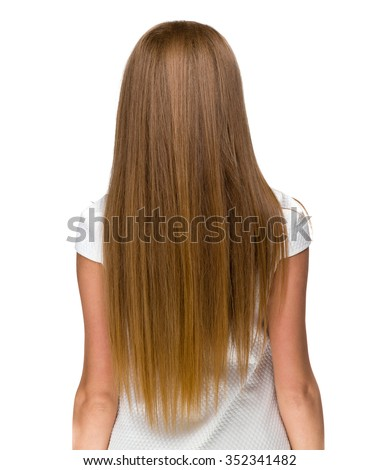 Back view of woman with long hair posing at studio. Isolated on white background. - stock photo