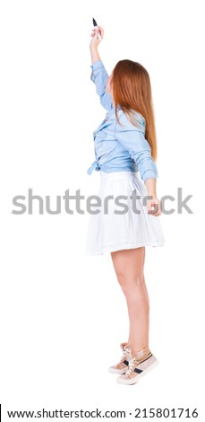 back view of writing beautiful redhead woman. Young girl in dress draws. Rear view people collection. backside view of person. Isolated over white background - stock photo