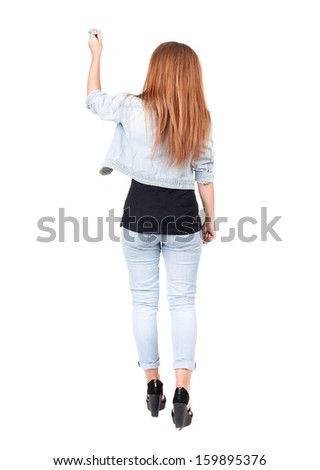 back view of writing beautiful redhead woman. Young girl in jeans draws. Rear view people collection. backside view of person. Isolated over white background - stock photo
