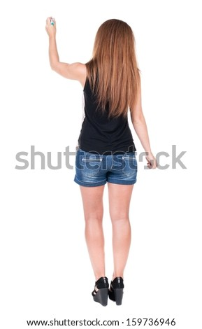 back view of writing beautiful redhead woman. Young girl in shorts draws. Rear view people collection.  backside view of person. Isolated over white background. - stock photo