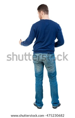 back view of writing business man. bearded man in blue pullover draws a felt-tip pen at the bottom.