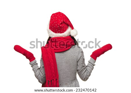 Back view of Xmas woman wearing Santa hat looking at blank copy space and shrugging her shoulders, over white background - stock photo