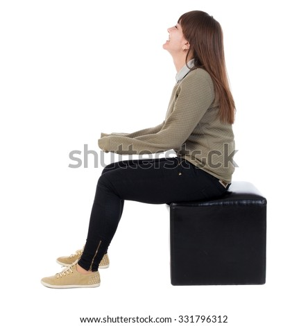 back view of young beautiful  woman sitting.  girl  watching. Rear view people collection.  backside view of person.  Isolated over white background.   - stock photo