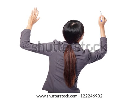 back view of Young business woman with pen writing something on the air isolated on white background. great for you add stock graph, asian woman model - stock photo