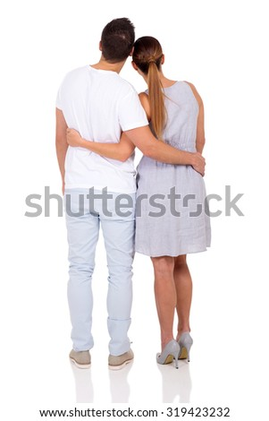 back view of young couple isolated on white background - stock photo