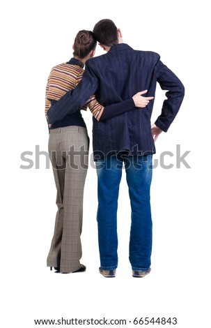Back view of young couple looks where that. Rear view. Isolated over white. - stock photo