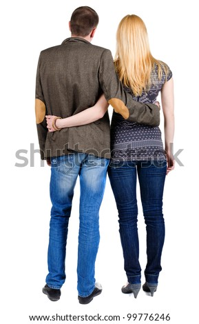 Back view of young couple (man and woman) hug and look into the distance. beautiful friendly girl and guy together. Rear view. Isolated over white background.