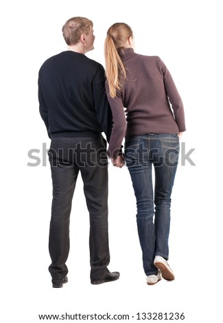 Back view of young couple (man and woman)  look into the distance. beautiful friendly girl and guy together. Rear view. Isolated over white background. husband and wife smiling coyly looking sideways