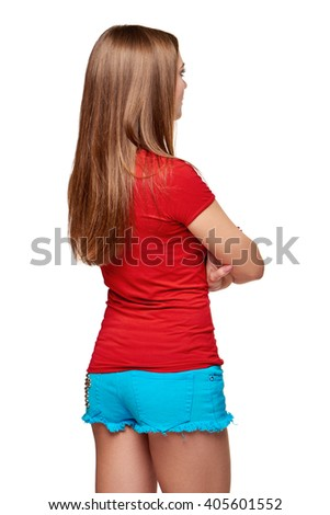 Back view of young female looking at blank copy space with folded hands, over white background - stock photo