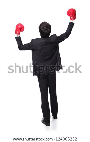 back view of young handsome Businessman win pose with boxing gloves and raise his arms in full length isolated on white background, asian model - stock photo