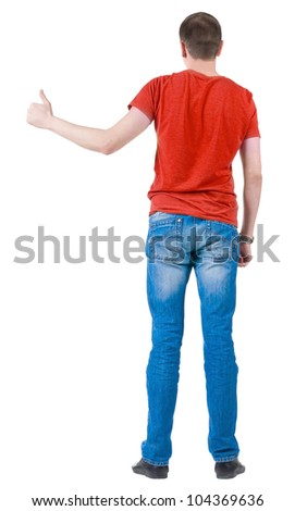 Back view of young men in  red t-shirt going thumb up. Rear view. Isolated over white background. Guy  looks away and showing of positive emotions with OK sign concept . - stock photo